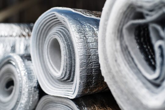 Thermal insulation with laminated reflective aluminum foil in large rolls. Close-up