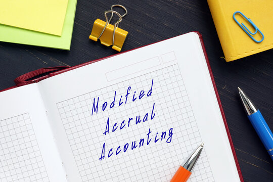 Business concept meaning Modified Accrual Accounting with phrase on the page.