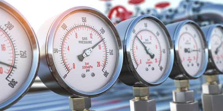 Row of gas pression gauge meters on gas pipeline. Gas extraction, production, delivery and supply concept.
