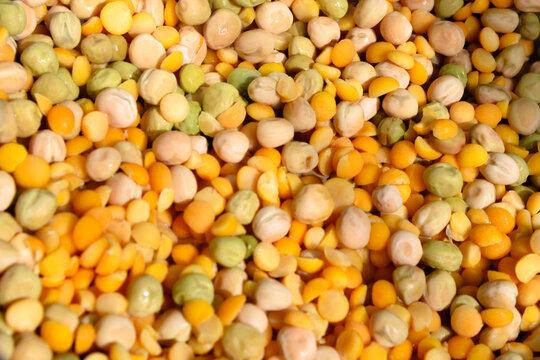 Washed pea fruit (whole, split). Background