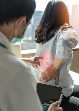Back pain, lower back ache, muscle or spine injury in menopause woman patient with backache from osteoporosis disease or office syndrome seeing orthopedic surgical doctor for medical treatment