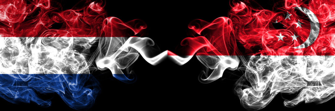 Netherlands vs Singapore smoky mystic flags placed side by side. Thick colored silky abstract smoke flags.