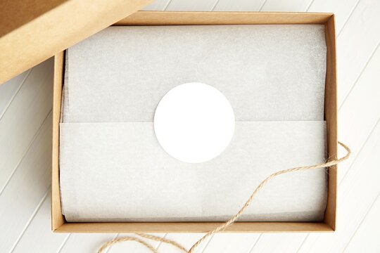 Round sticker mockup for gift, product label mockup, circle gift tag, thank you sticker on kraft paper box.