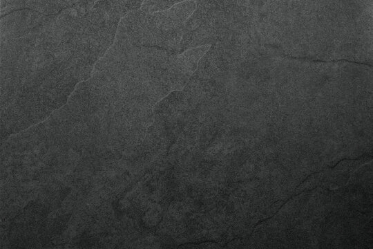 Beautiful background of a dark slate stone in close-up. Ideal for culinary or product presentation project.