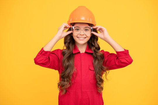 happy teenager girl in protective eyeglasses and helmet, engineer