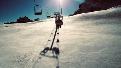 Ski Lift On Snowcapped Mountains Against Sky