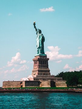 River Against Statue Of Liberty In City