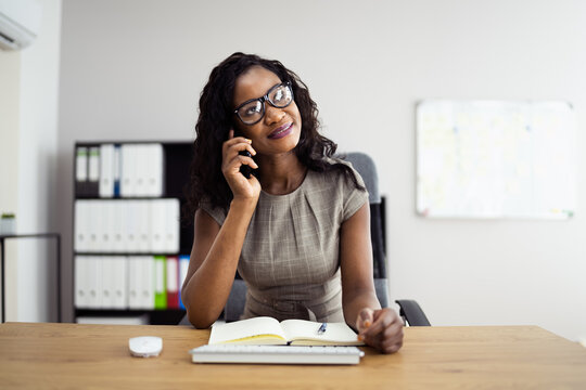 African American Business Woman Calling On Phone