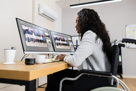 Disabled African Worker In Wheelchair Using Computer