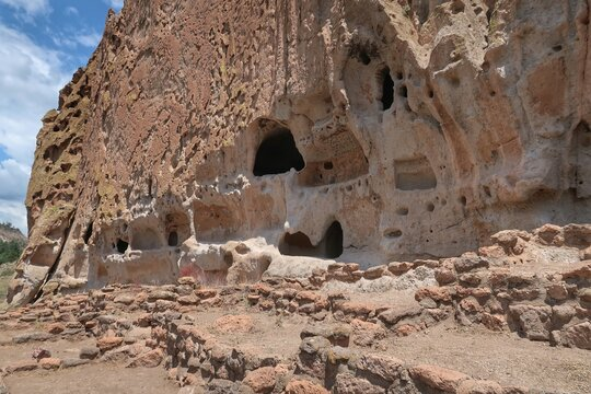 Landscape Of A Cliff Face With Holes And Rooms In Bandelier National Monument