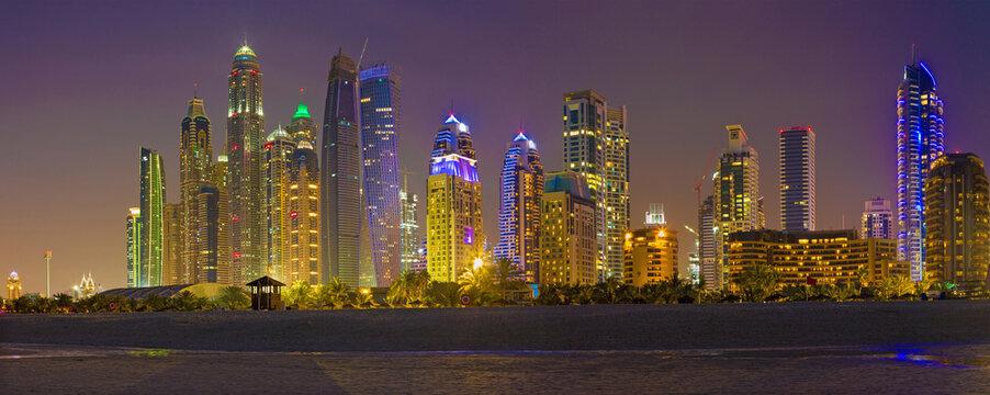 DUBAI, UAE - MARCH 28, 2017: The evening skyline of Marina towers from beach.
