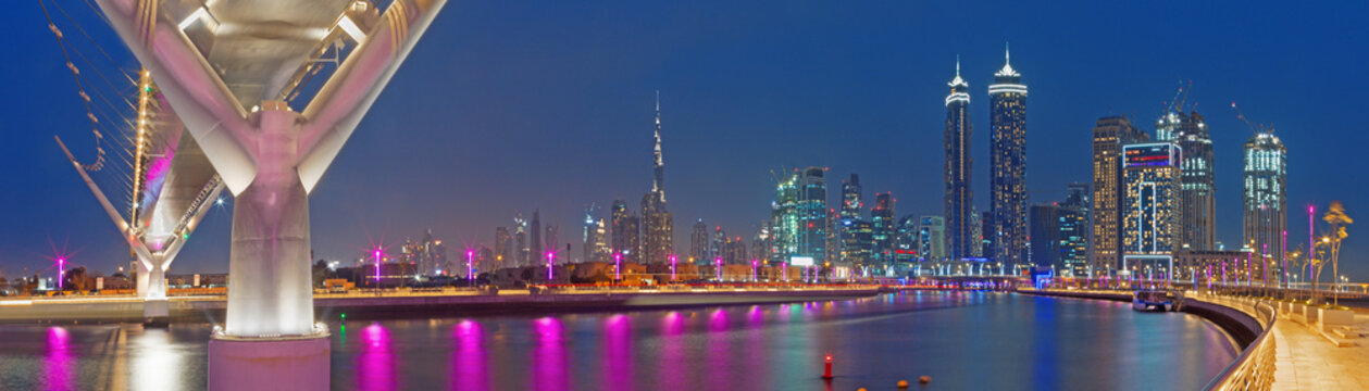DUBAI, UAE - MARCH 27, 2017: The evening skyline with the bridge over the new Canal and Downtown.