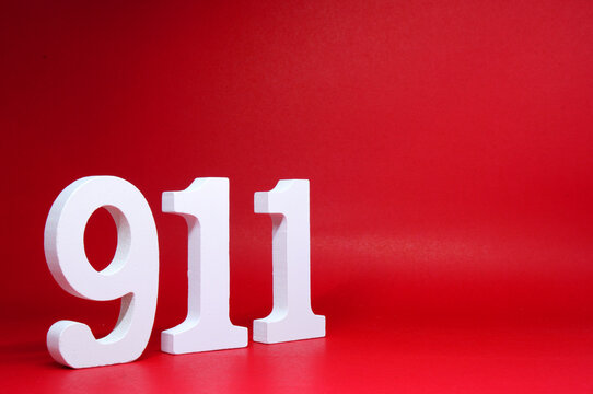 Number Nine One One ( 911 ) on Red Background with Copy Space - Police emergency call number Concept