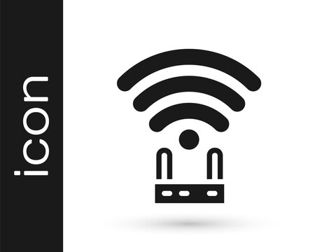 Black Router and wi-fi signal icon isolated on white background. Wireless ethernet modem router. Computer technology internet. Vector.