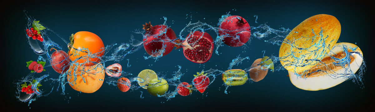Panorama with fruits in water - currants, persimmon, plum, lychee, pomegranate, strawberry, lime, melon, kiwi - cheerfulness of spirit and body every day