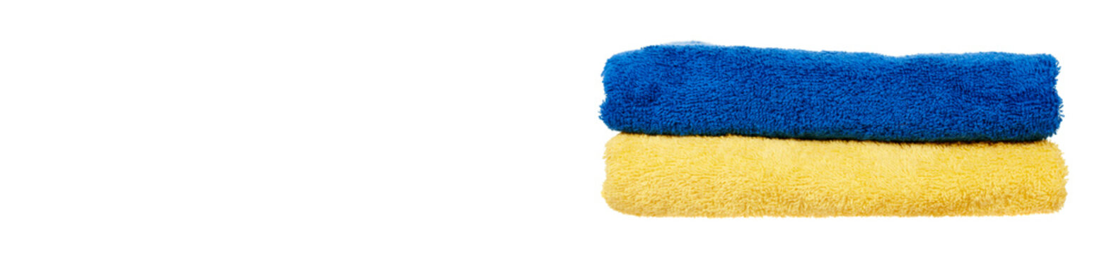 Blue and with yellow cotton towels isolated on white background.