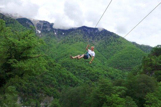 Portrait Of Man Ziplining