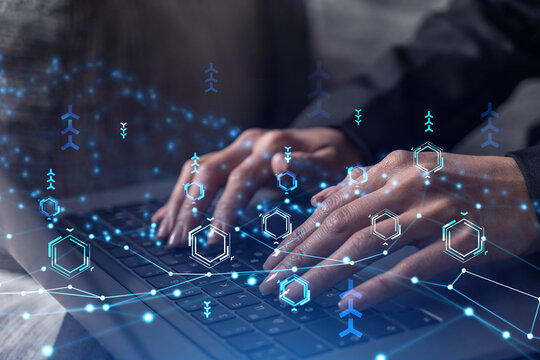 Woman typing the keyboard to create innovative software to change the world and provide a completely new service. Close up shot. Hologram tech graphs. Concept of Dev team. Formal wear.
