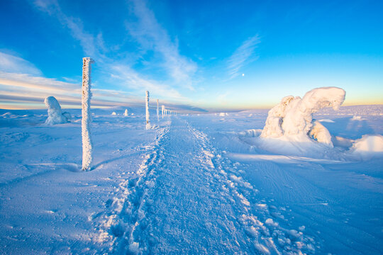 trail in Karkonosze mountain in Poland and Czech republic border during winter sunrise
