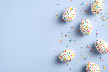 Creative layout with colorful Easter eggs on blue background. Happy Easter banner mockup. Minimal...