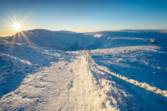 trail in Karkonosze mountain in Poland and Czech republic border during winter sunset