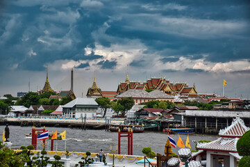 Landscape view of the beautiful traditional Thai roofs of the Grand Palace from Wat Arun Wall mural
