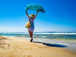 Middle-aged woman walking on beach