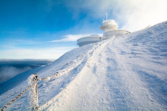 peak of Sniezka mountain in Karkonosze in Poland and Czech republic border during winter