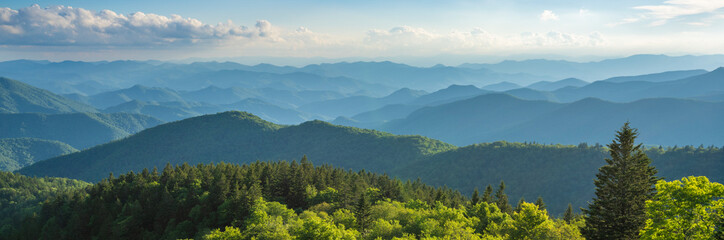 Blue Ridge Parkway summer Landscape. Beautiful mountain panorama with green mountains and layers of  hills. Near Asheville, North Carolina. Image for web header or banner.