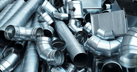 Fototapeta Pile of pipes and parts for duct systems. Industrial ventilation obraz
