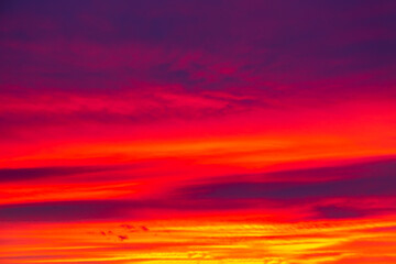 Vivid saturated beautiful sunset sky in red, purple and blue colors. Sunset background