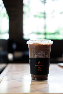 Samut Prakan, Thailand - February 7, 2021 : Iced mocha coffee in size tall glass at Starbucks Reserve, Mega Bangnashopping mall