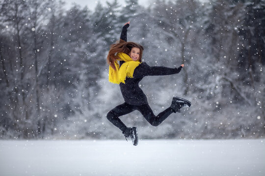 Girl jumping in the snow