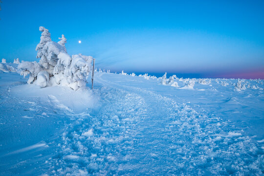 pathway in Karkonosze mountains at dusk during winter in Poland and Czech republic