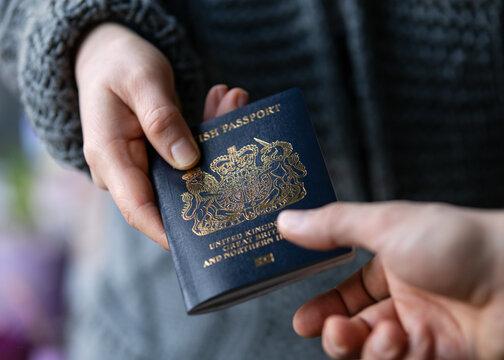 man handing new post Brexit blue British passport Devon, United Kingdom, January, 2021