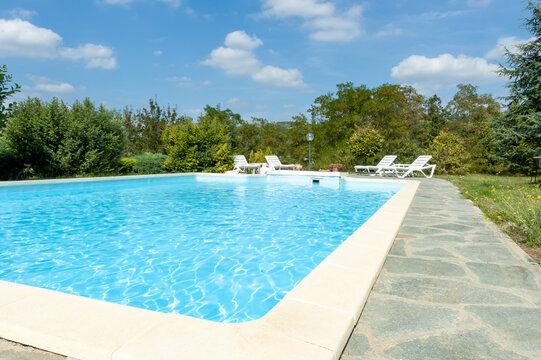 Swimming pool in italian home garden