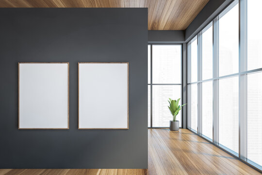 Modern office entrance area with grey wall wooden parquet. Panoramic city view windows. Two canvas poster on wall. Mock up.
