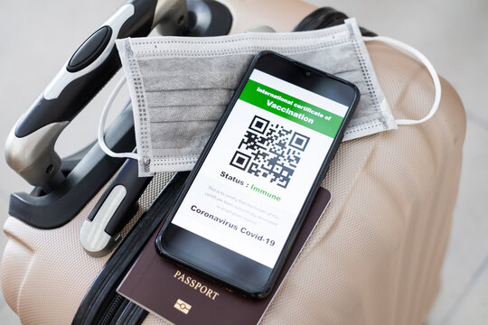 Traveler shows health passport of vaccination certification on phone at airport, to certicy that have been vaccinated of coronavirus covid-19