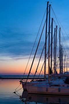 Various ships and boats in a marina of Thessaloniki, Greece at sunset
