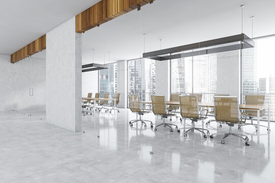 Glass conference room with furniture near window in business office