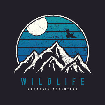 Mountain typography graphics for slogan tee shirt with eagle. Mountain adventure print for apparel, t-shirt design with grunge. Wildlife slogan. Vector illustration.