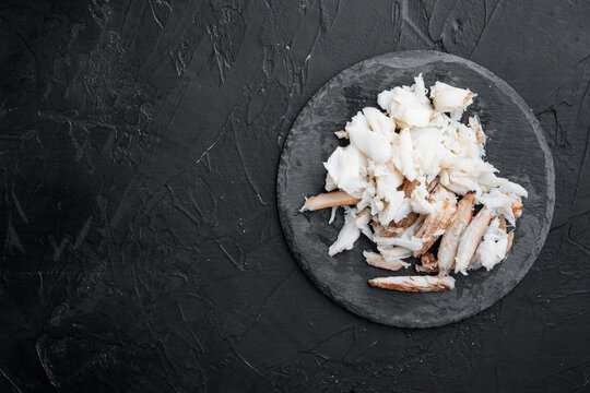 Boiled blue swimming crab meat, on black background, top view flat lay  , with copyspace  and space for text