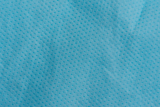 Blue spunbond texture background. Spunbond is type of nonwoven and made from polypropylene. homemade virus Pandemic Protection Concept. close up surface of spunbond. Medical face mask material