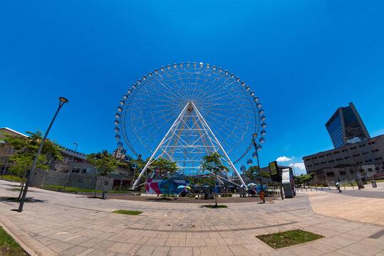 Rio de Janeiro, Brazil - January 14, 2021: Distorted fish eye view of Rio Star ferris wheel in Olympic Boulevard.