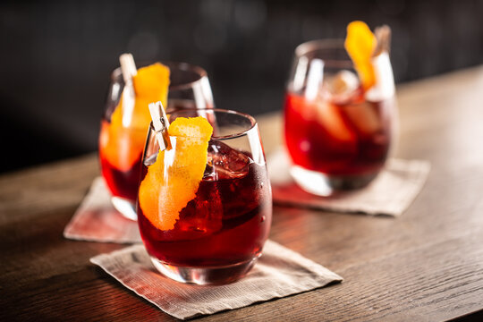 Negroni classic cocktail and gin short drink with sweet vermouth, red bitter liqueur and dried orange garnish