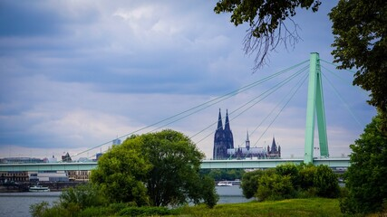 Cathedral And Bridge Against Cloudy Sky Fotobehang