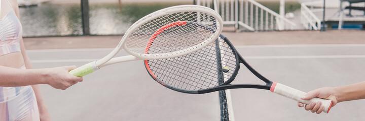 Fototapeta Racquet tap, greeting or finishing tennis game post covid 19 coronavirus pandemic, new normal sport concept obraz
