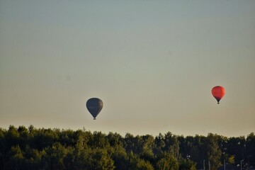 Hot Air Balloons Flying Against Sky During Sunset