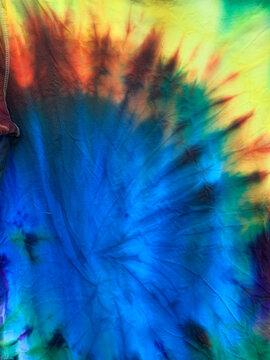 Bright blue, green, orange, and yellow patterned Tye Dye T-shirts