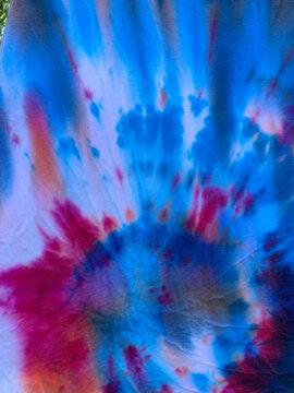 Red, white, and blue closeup of Tye Dye T-shirts pattern